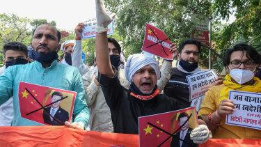 Activists from Swadeshi Jagran Manch, a wing of the Hindu nationalist organisation Rashtriya Swayamsevak Sangh (RSS), shout slogans during a protest outside the Chinese Embassy in New Delhi, India.