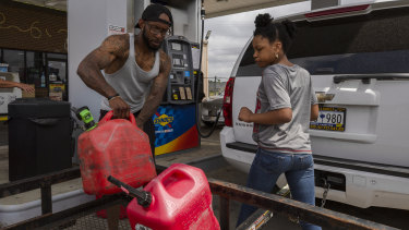 Shortages: A man fills a jerry can with fuel at a Sunoco petrol station in Sumter, South Carolina.