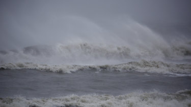 Waves break on the beach during Hurricane Dorian in Folly Beach, South Carolina.