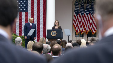 Closely clustered people at the Rose Garden event on Saturday for Amy Coney Barrett, US President Donald Trump's nominee for associate justice of the Supreme Court.