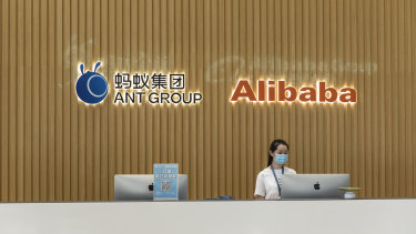 The Ant Group Co. logo and the AlibabaGroup Holding Ltd. logo are displayed behind a reception desk at the company's headquarters in Hangzhou, China.