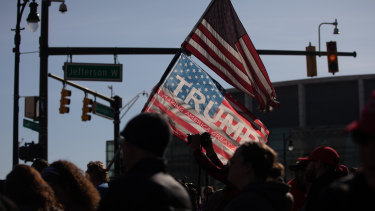 Demonstrators wave American flags at a pro-Trump protest in front of the TCF Centre during the 2020 Presidential election in Detroit, Michigan.