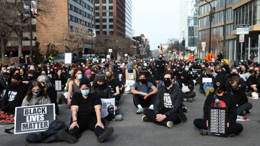 Demonstrators sit for a moment of silence during a protest in Minneapolis, Minnesota, US.
