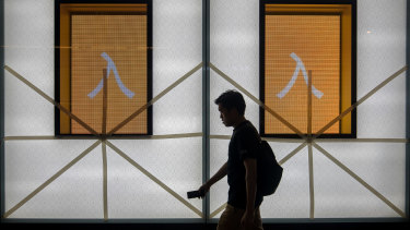 Tape fixed to window panes during preparations ahead of Super Typhoon Mangkhut's arrival at Causeway Bay Hong Kong, China, on Saturday.