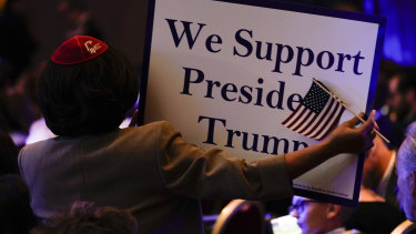 An attendee holds a sign during the Republican Jewish Coalitions National Leadership Meeting in Las Vegas, Nevada.