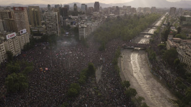 People gather during an anti-government protest in Santiago, Chile.