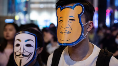 Masked 'Halloween' protesters walk in the Central district of Hong Kong, China, on Thursday.