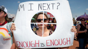 A demonstrator holds a sign in El Paso, Texas.