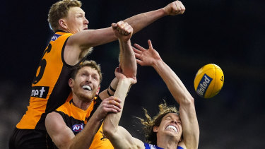 Double-teamed: North forward Ben Brown is kept out of the contest by Hawks defenders James Sicily (left) and Ben McEvoy.