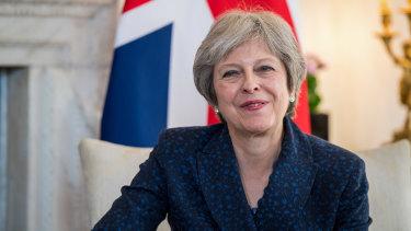 Under pressure: Theresa May.