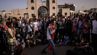 An activist addresses a gathering crowd during a sit-in near one of the gates to Sudan's military headquarters in Khartoum before this week's violence.