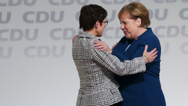 Angela Merkel, right, congratulates Annegret Kramp-Karrenbauer on becoming the head of Germany's ruling party last year.