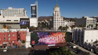 "A ""Don't Share Air"" billboard at Hollywood and Highland in Los Angeles, California, US."
