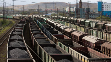 Ready to export: Freight wagon filled with coal line the railway tracks at Russia's Murmansk station.