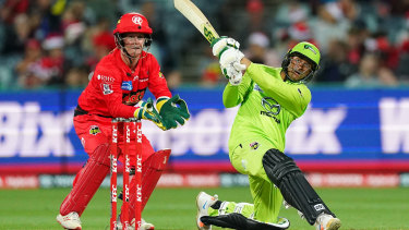 Usman Khwaja on the way to making 50 in the Sydney Thunder's BBL clash against the Melbourne Renegades.