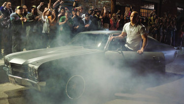 Dom Toretto (played by Vin Diesel) and the 1970 Chevy Chevelle in the 2009 movie Fast & Furious.