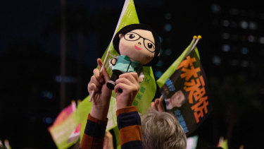 An attendee holds a doll in the likeness of Taiwanese President Tsai Ing-wen during a rally for her campaign in Taipei on Friday.