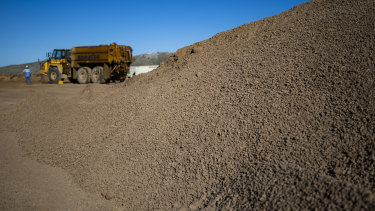 A mountain of crushed ore awaits processing by America's only rare earths producer, MP Materials, in California.