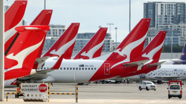 Qantas will suspend international flights and temporarily stand down two-thirds of its workforce from the end of March.