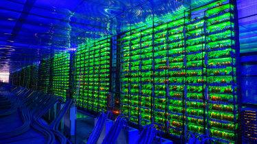 Illuminated cryptocurrency mining rigs.