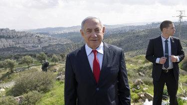 Israeli Prime Minister Benjamin Netanyahu stands at an overview of the Israeli West Bank Israeli settlement of Har Homa where on Thursday he announced a new Israeli neighbourhood is to be built.