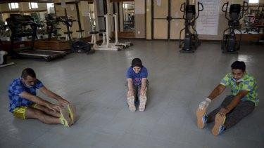 Pakistanis return to gyms in Peshawar, Pakistan on August 10.