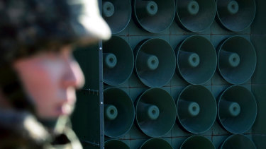 A South Korean army soldier stands near the loudspeakers near the border area between South Korea and North Korea in Yeoncheon, South Korea..