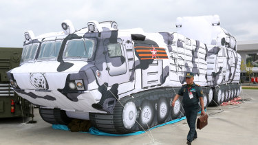 A visitor walks past an inflatable model of a TOR-M2DT Arctic short-range air defence missile system at the Army 2018 expo in Kubinka, Russia.