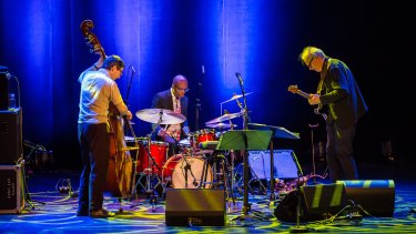 The Bill Frisell Trio, with Thomas Morgan (bass) and Rudy Royston (drums) .