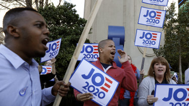 People cheer and hold signs in support of Joe Biden in Las Vegas, Nevada.