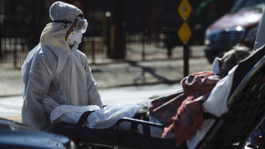 A patient is brought into the Elmhurst Hospital Centre in the Queens borough of New York.