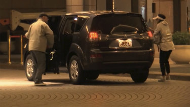 China Innovation Investment officials Xiang Xin and his wife Gong Qing get out of a car at the Grand Hyatt hotel in Taiwan.