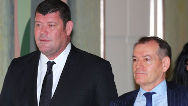 John Alexander (left), pictured with Crown's major shareholder James Packer in 2017, stepped down from the top job in January but remains on Crown's board.
