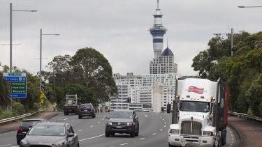 Traffic moves along in Auckland, New Zealand, where the economy is in better shape than in Australia.