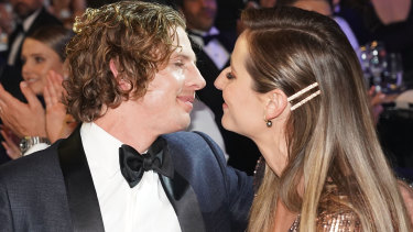 Nat Fyfe is congratulated by his partner Eleanor Brayshaw.