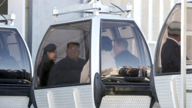 The two couples take a cable car to Mount Paektu in North Korea.
