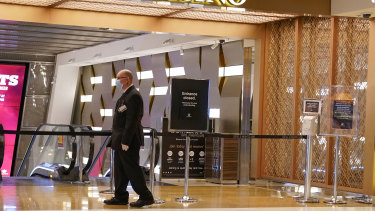 A security guard outside Crown Casino on Monday.