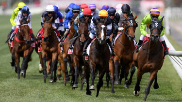 Race leaders Cismonte (right), Boomtime (second right) and Gallante (centre) pass the finish post on the first lap during the Melbourne Cup at Flemington Racecourse in Melbourne, Tuesday, November 7, 2017.