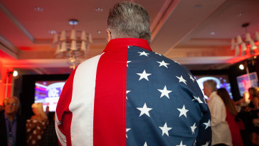 An attendee wears an American flag themed shirt during an election night rally for Rick Scott, winning Republican governor of Florida.