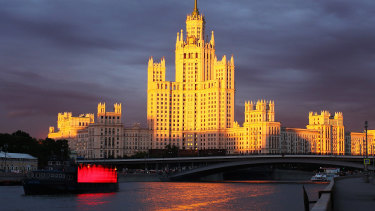 Cruise boats sail along the Moscow river near the Kotelnicheskaya embankment building. Trump has always wanted to have his name in lights in Moscow.