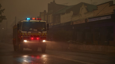 An RFS truck travels through Bundanoon as rain begins to fall in January.