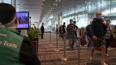 Passengers arrive at Singapore's Changi Airport.