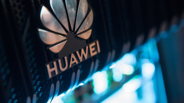 A corporate logo sits on a Huawei Technologies router at a 5G event in London, UK.