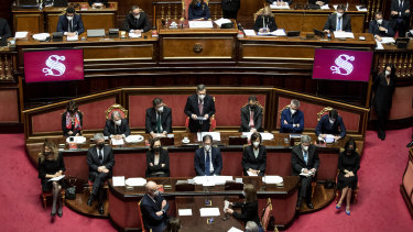 Prime Minister Mario Draghi, centre, delivers his first speech in the Senate.