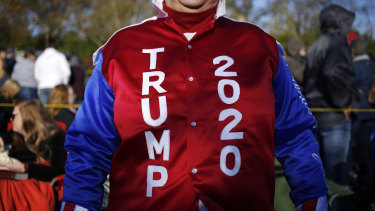 """An attendee wearing a """"TRUMP 2020"""" jacket waits in line to enter a rally with President Trump, not pictured, earlier this week in Kentucky."""