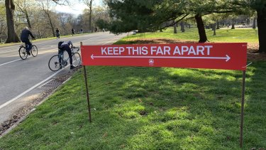 Signage urging social distancing is seen in Prospect Park in the Brooklyn borough of New York.