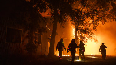 The wildfire that erupted in California's wine country minutes after a PG&E power line went down has prompted an expanded evacuation order, as officials warn high winds could drive the blaze toward one of the region's largest towns.