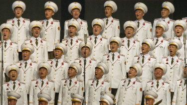 North Korean military choir members sing during an evening gala on Saturday.