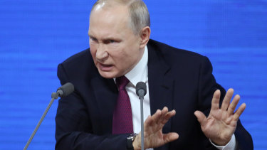 Vladimir Putin speaks at his annual press conference in Moscow.