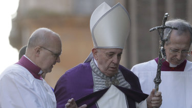 Pope Francis walks in procession to the Basilica of Santa Sabina before the Ash Wednesday Mass.